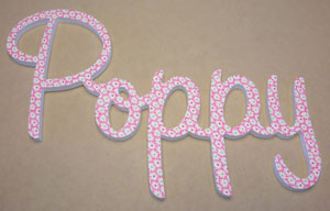 Custom made wooden name in fabric finish